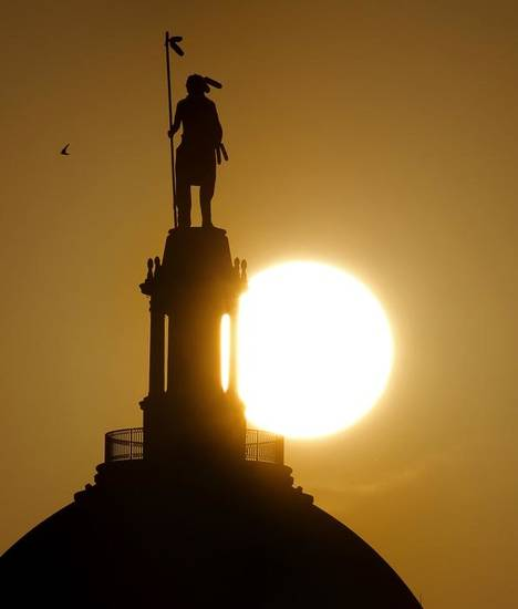"SUNSET: The sun sets behind Kelly Haney's sculpture ""The Guardian"" atop the state Capitol in Oklahoma City, Saturday, July 9, 2011. Photo by Bryan Terry, The Oklahoman ORG XMIT: KOD"