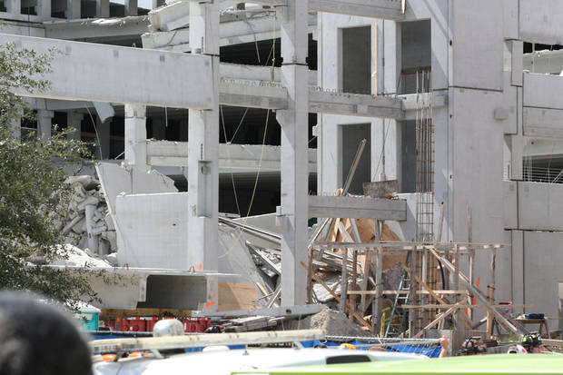 A general view of the West Campus parking lot of Miami-Dade College in Doral, Fla., on Wednesday, Oct. 10, 2012. A section of the parking garage under construction collapsed Wednesday, trapping some workers and shaking the buildings around it. (AP Photo/El Nuevo Herald, Hector Gabino) MAGS OUT