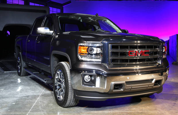 The 2014 GMC Sierra debuts in Pontiac, Mich., Thursday, Dec. 13, 2012. General Motors unveiled a new versions of its top-selling Chevrolet Silverado and GMC Sierra on Thursday Dec. 13, 2012. The 2014 models will go on sale by early spring or late summer. The models roll into a market where truck sales are growing after a five-year slump. (AP Photo/Paul Sancya)