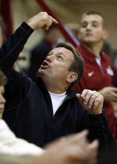 Football head coach Bob Stoops talks with someone in the upper deck as the University of Oklahoma (OU) Sooners men's basketball team plays the Central Oklahoma Bronchos at McCasland Field House on Wednesday, Nov. 7, 2012  in Norman, Okla. Photo by Steve Sisney, The Oklahoman