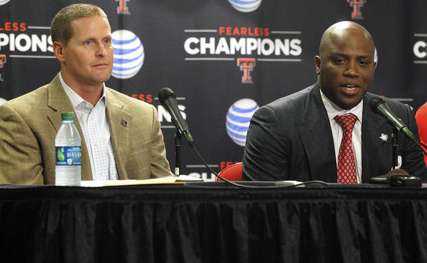 Texas Tech interim head coach Chris Walker, right, speaks next to athletic director Kirby Hocutt during an NCAA college basketball news conference in Lubbock, Texas, Thursday, Oct. 4, 2012. (AP Photo/The Avalanche-Journal, Zach Long) ALL LOCAL TV OUT