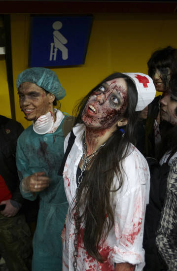 People dressed and made up as Zombies     during the annual Zombie march in Madrid, Saturday Feb. 27, 2010. The zombie march is in homage by fans to the Zombie film genre and to U.S. director George A. Romero, famous for his Zombie horror movies. (AP Photo/Paul White)