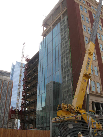 A modern glass facade is going up on the east alley side of the Braniff Building as renovations continue as part of the SandRidge Commons. <strong>Steve Lackmeyer</strong>