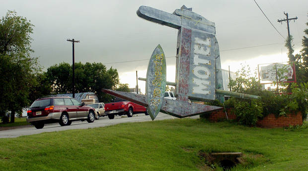 The historic Route 66 sign for the Rio Siesta Motel (which is now a strip shopping center) blew down during 90 MPH high winds in Clinton.  Interstate 44 was closed due to downed power lines, and traffic was diverted to SH 66 (behind the sign) and was backed up for several miles.  Clinton, Oklahoma 06/12/05.   Photo by Michael Downes, The Oklahoman.