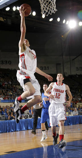 Forgan's Rhett Radcliff goes to the basket beside Ryan Radcliff during the semifinal game of the Class B boys state basketball tournament at State Fair Arena in Oklahoma CIty, Friday, March 3, 2012. Photo by Bryan Terry, The Oklahoman