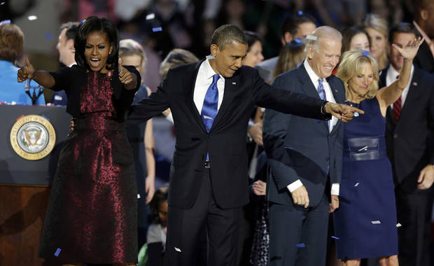 President Barack Obama, first lady Michelle Obama, Vice President Joe Biden and Jill Biden acknowledge the crowd at his election night party Wednesday, Nov. 7, 2012, in Chicago. President Obama defeated Republican challenger former Massachusetts Gov. Mitt Romney. (AP Photo/Chris Carlson)