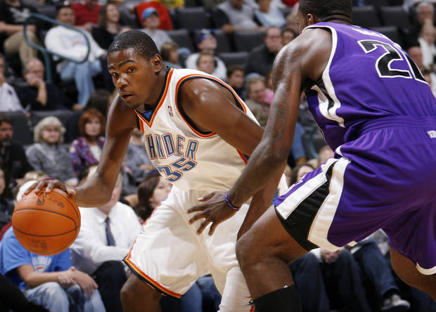 Oklahoma City's Kevin Durant (35), left, tries to drible around Donte Greene (20) of Sacramento during the NBA preseason game between the Sacramento Kings and the Oklahoma City Thunder at the Ford Center in Oklahoma City, Thursday, Oct. 22, 2009. Photo by Nate Billings, The Oklahoman