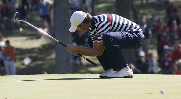 USA's Webb Simpson reacts after missing a putt on the 12th hole during a singles match at the Ryder Cup PGA golf tournament Sunday, Sept. 30, 2012, at the Medinah Country Club in Medinah, Ill. (AP Photo/Charles Rex Arbogast)  ORG XMIT: PGA149