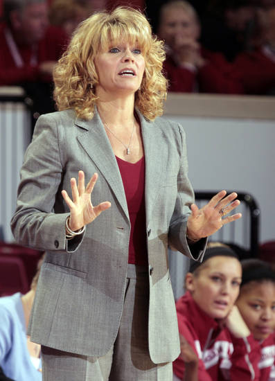 Oklahoma Sooner head coach Sherri Coale calms her team in the first half as the University of Oklahoma Sooners (OU) play the West Virginia Mountaineers in NCAA, women's college basketball at The Lloyd Noble Center on Wednesday, Jan. 2, 2013  in Norman, Okla. Photo by Steve Sisney, The Oklahoman