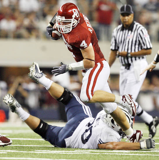 OU&amp;#8217;s Ryan Reynolds, top, is tripped up on an interception return by BYU&amp;#8217;s Matt Reynolds in the first quarter  Saturday.  Photo by Nate Billings, The Oklahoman