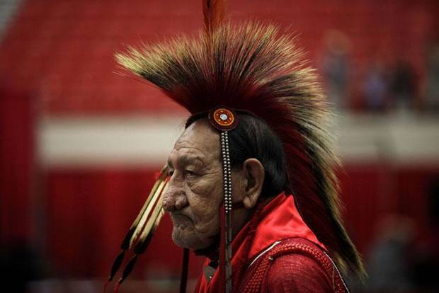 RED EARTH NATIVE AMERICAN CULTURAL FESTIVAL: A participant enters the arena during the grand entry at the Red Earth Festival at the Cox Convention Center in Oklahoma CIty, Sunday, June 20, 2010. Photo by Sarah Phipps, The Oklahoman      ORG XMIT: KOD