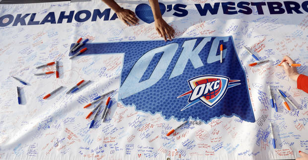 People sign a banner for Oklahoma City's Russell Westbrook (0)  before Game 5  in the first round of the NBA playoffs between the Oklahoma City Thunder and the Houston Rockets at Chesapeake Energy Arena in Oklahoma City, Wednesday, May 1, 2013. Photo by Sarah Phipps, The Oklahoman