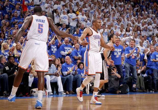 Oklahoma City's Russell Westbrook (0) celebrates with Oklahoma City's Kendrick Perkins (5) during Game 4 of the Western Conference Finals between the Oklahoma City Thunder and the San Antonio Spurs in the NBA playoffs at the Chesapeake Energy Arena in Oklahoma City, Saturday, June 2, 2012. Oklahoma CIty won 109-103. Photo by Bryan Terry, The Oklahoman