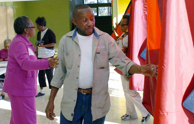 John Ford of Alexandria, La., gets ready to cast his vote at Precinct C07 at Peabody Magnet High School Tuesday, Nov. 6, 2012 in Alexandria. (AP Photo/The Daily Town Talk, Melinda Martinez) NO SALES