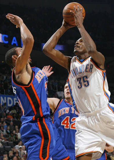 Kevin Durant (35) of Oklahoma City tries to get the ball past Jared Jeffries (20) of New York during the NBA basketball game between the Oklahoma City Thunder and the New York Knicks at the Ford Center in Oklahoma City, January 11, 2010. Photo by Nate Billings, The Oklahoman