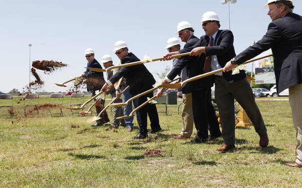 Dignitaries participate in a groundbreaking ceremony for the addition to the Outlet Shoppes in west Oklahoma City, OK, Tuesday, May 15, 2012,  By Paul Hellstern, The Oklahoman