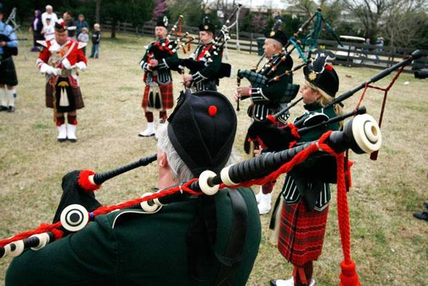Members of the Pipes and Drums of the Highlander's of Oklahoma play after the opening ceremonies at the Iron Thistle Scottish Heritage Festival and Highland Games at the Kirkpatrick Family Farm in Yukon Saturday March 21, 2009. Photo by Doug Hoke, The Oklahoman