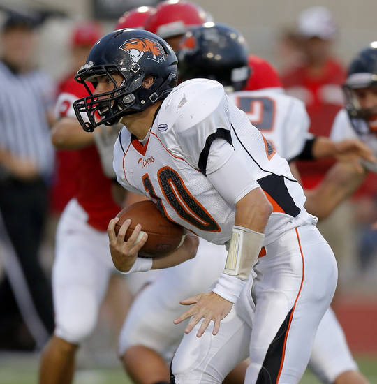 Coweta's Hayden Holmes runs against Carl Albert during a high school football game at Carl Albert in Midwest City, Friday, September 7, 2012. Photo by Bryan Terry, The Oklahoman