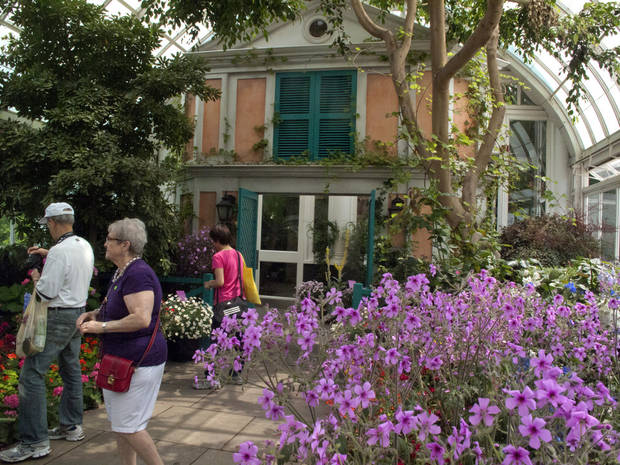"In this May 26 photo, a replica of the facade of French impressionist artist Claude Monet�s pink stucco house is featured in an exhibition at the New York Botanical Garden in New York.  ""Monet's Garden,"" evokes the artist's garden at Giverny, his home in France from 1883 until his death in 1926. It runs through Oct. 21. (AP Photo/Ray Stubblebine) <strong>Ray Stubblebine - AP</strong>"