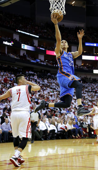Oklahoma City's Kevin Martin goes to the basket past Houston's Jeremy Lin during Game 3 in the first round of the NBA playoffs between the Oklahoma City Thunder and the Houston Rockets at the Toyota Center in Houston, Texas, Sat., April 27, 2013. Photo by Bryan Terry, The Oklahoman