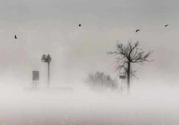 Fog gathers over  Lake Winnebago during a stretch of  bitter cold weather Tuesday Jan. 22, 2013, in Menasha, Wis.  The upper Midwest is in a third straight day of bitter cold temperatures.  (AP Photo/The Post-Crescent, William Glasheen ) NO SALES Wm. Glasheen/The Post-Crescent