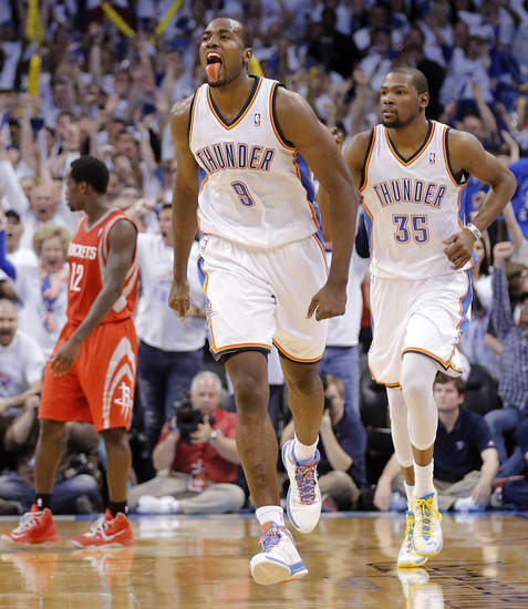 Oklahoma City's Serge Ibaka (9) reacts after hitting a shot late in the game during Game 2 in the first round of the NBA playoffs between the Oklahoma City Thunder and the Houston Rockets at Chesapeake Energy Arena in Oklahoma City, Wednesday, April 24, 2013. Photo by Chris Landsberger, The Oklahoman