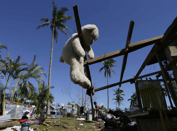 A stuffed toy hangs to dry from a damaged house at New Bataan township, Compostela Valley in southern Philippines Saturday Dec. 8, 2012. Search and rescue operations following typhoon Bopha that killed nearly 600 people in the southern Philippines have been hampered in part because many residents of this ravaged farming community are too stunned to assist recovery efforts, an official said Saturday. (AP Photo/Bullit Marquez)