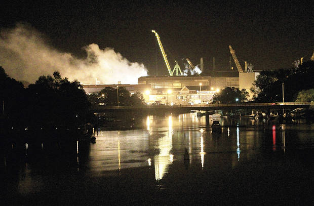 FILE - In a Wednesday, May 23, 2012 file photo, smoke rises from a dry dock as fire crews respond to a fire on the USS Miami SSN 755 submarine at the Portsmouth Naval Shipyard on an island in Kittery, Maine. U.S. Attorney Thomas Delahanty II said 24-year-old Casey James Fury waived indictment and pleaded guilty Thursday, Nov. 8, 2012 to two counts of arson for setting the fire that caused about $450 million in damage, in Portland, Me. (AP Photo/The Herald, Ionna Raptis, File)
