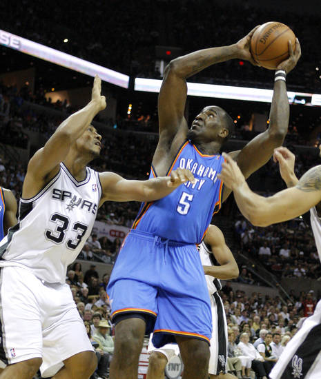 Oklahoma City's Kendrick Perkins (5) goes to the basket beside San Antonio's Boris Diaw during Game 1 of the Western Conference Finals between the Oklahoma City Thunder and the San Antonio Spurs in the NBA playoffs at the AT&T Center in San Antonio, Texas, Sunday, May 27, 2012. Photo by Bryan Terry, The Oklahoman