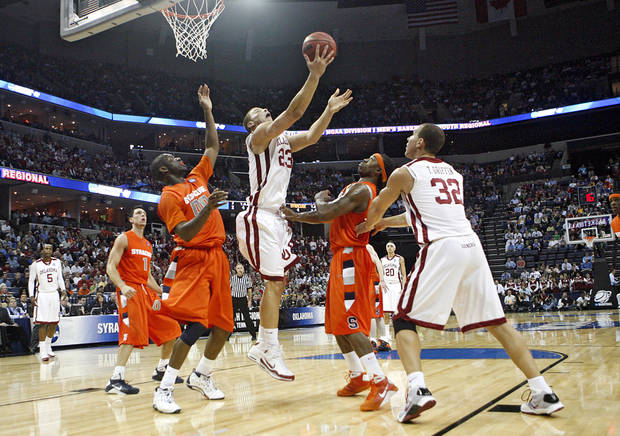 Oklahoma's Blake Griffin (23) puts up a reverse layup over the Syracuse defense during the first half of the NCAA Men's Basketball Regional at the FedEx Forum on Friday, March 27, 2009, in Memphis, Tenn.