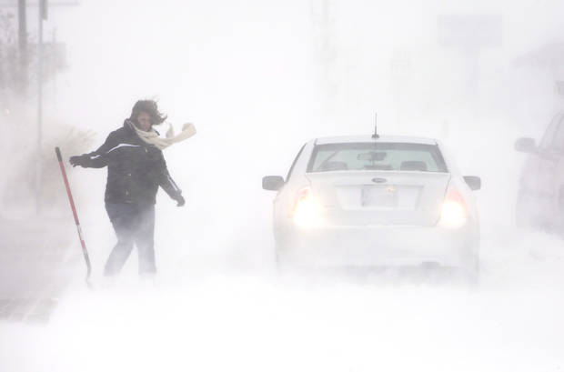 A stranded motorist reaches for her shovel to try and dig out her car on 15th just west of Broadway in Edmond, Wednesday, February 1, 2011.      Photo by David McDaniel, The Oklahoman