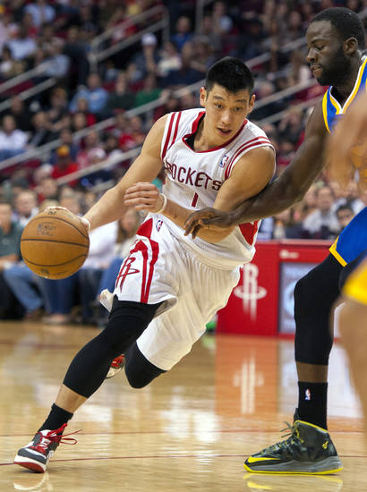 Houston Rockets' Jeremy Lin drives against Golden State Warriors' Draymond Green, right, during the fourth quarter of an NBA basketball game, Tuesday, Feb. 5, 2013, in Houston. The Rockets beat the Warriors 140-109. (AP Photo/Dave Einsel)