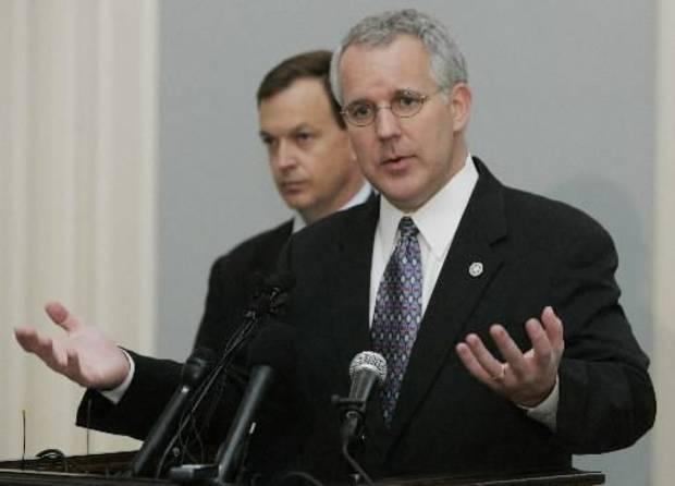 Oklahoma Gov. Brad  Henry, right, gestures as he speaks during a news conference in Oklahoma City, Thursday, Oct. 9, 2008.  Henry said Oklahoma's economy, banks and revenue are strong compared to other states. Oklahoma state Treasurer Scott  Meacham is at left. (AP Photo)