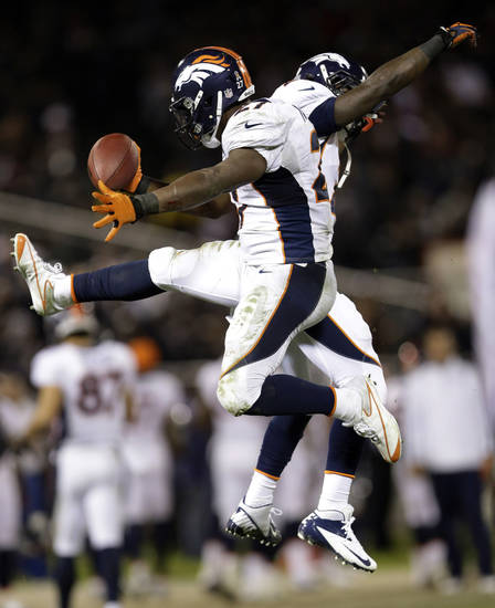 Denver Broncos running back Knowshon Moreno celebrates after scoring a touchdown on a 1-yard run during the third quarter of an NFL football game against the Oakland Raiders in Oakland, Calif., Thursday, Dec. 6, 2012. (AP Photo/Marcio Jose Sanchez)
