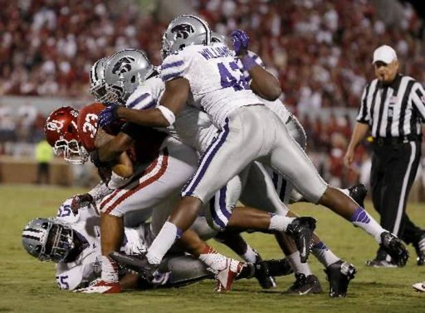 klahoma's Trey Millard (33) is brought down by a group of Kansas State defenders on Saturday, September 22, 2012. Oklahoma lost 24-19. Photo by Bryan Terry, The Oklahoma