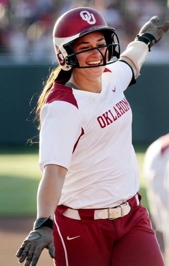 Sooner Lauren Chamberlain flies home after a home run in early innings as the University of Oklahoma (OU) Sooners play the Oklahoma State University Cowgirls in NCAA college softball at Marita Hines Field on Wednesday, April 25, 2012, in Norman, Okla. Photo by Steve Sisney, The Oklahoman