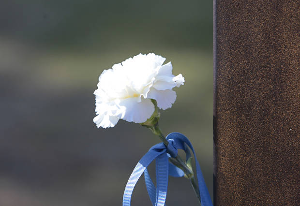 Carnation on Michael Weavers chair during the 18th Anniversary Remembrance Ceremony at the Oklahoma City National Memorial and Museum, Friday, April 19, 2013. Photo By David McDaniel/The Oklahoman