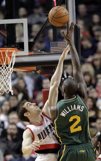Utah Jazz forward Marvin Williams, right, shoots over Portland Trail Blazers forward Victor Claver during the first quarter of an NBA basketball game in Portland, Ore., Saturday, Feb. 2, 2013. (AP Photo/Don Ryan)