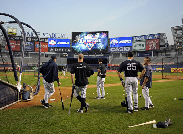 New York Yankees players work out during a baseball practice, Friday, Oct. 5, 2012, at Yankee Stadium in New York. They are preparing to play either the Baltimore Orioles or Texas Rangers in the American League division series. (AP Photo/Bill Kostroun)