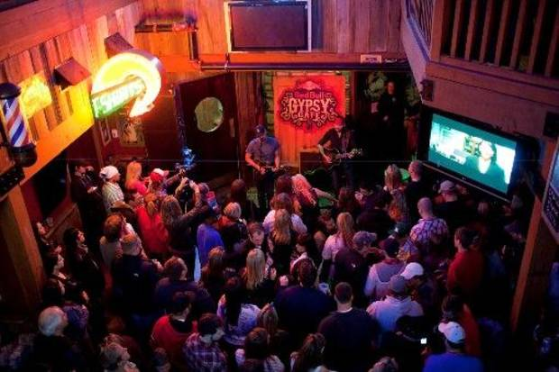 Musicians John Cooper, left, and Stoney LaRue perform together April 15 at Eskimo Joe's in Stillwater. Several musicians reunited in Stillwater last month for the filming of a Red Bull mini-documentary about red dirt music. (Red Bull photo by Trevor Paulhus)