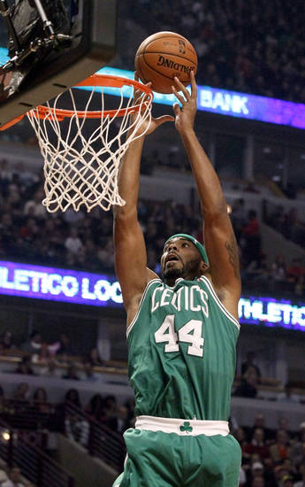 Boston Celtics forward Chris Wilcox scores on a lob pass from Rajon Rondo during the first half of an NBA basketball game against the Chicago Bulls, Monday, Nov. 12, 2012, in Chicago. (AP Photo/Charles Rex Arbogast)