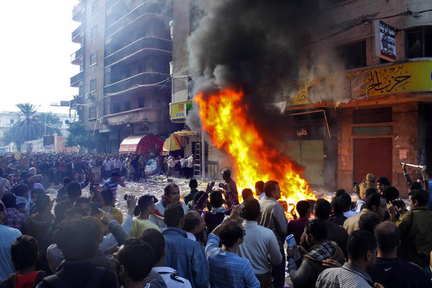   Protesters storm an office of Egyptian President Mohammed Morsi&#039;s Muslim Brotherhood Freedom and Justice party and set fires in the Mediterranean port city of Alexandria, Egypt, Friday, Nov. 23, 2012. State TV says Morsi opponents also set fire to his party&#039;s offices in the Suez Canal cities of Suez, Port Said and Ismailia. Opponents and supporters of Morsi clashed across Egypt on Friday, the day after the president granted himself sweeping new powers that critics fear can allow him to be a virtual dictator. (AP Photo/Amira Mortada, El Shorouk Newspaper) EGYPT OUT  