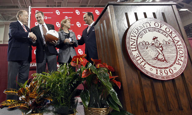 University of Oklahoma president David Boren shakes hands with new men's basketball coach Lon Kruger while athletic director Joe Castiglione speaks to Barbara Kruger during an event to  introduce Lon Kruger as the new University of Oklahoma men's basketball coach on Monday, April 4, 2011, in Norman, Okla.