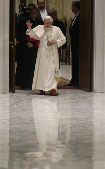 Pope Benedict XVI arrives for his weekly general audience at the Paul VI Hall at the Vatican, Wednesday Feb. 13, 2013. Thousands of people flooded the Vatican's main audience hall Wednesday for Pope Benedict XVI's first public appearance since his bombshell resignation announcement, taking advantage of his second-to-last public audience before retiring at the end of the month. (AP Photo/Alessandra Tarantino)