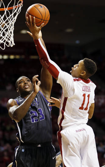 Oklahoma's Isaiah Cousins (11) takes a shot against TCU's Devonta Abron (23) during an NCAA men's basketball game between the University of Oklahoma (OU) and Texas Christian University (TCU) at the Lloyd Noble Center in Norman, Okla., Monday, Feb. 11, 2013. Photo by Nate Billings, The Oklahoman