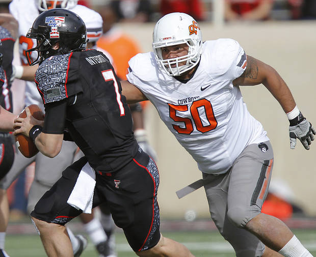 Oklahoma State Cowboys defensive end Jamie Blatnick (50) puts pressure on Texas Tech Red Raiders quarterback Seth Doege (7) during the college football game between the Oklahoma State University Cowboys (OSU) and Texas Tech University Red Raiders (TTU) at Jones AT&amp;T Stadium on Saturday, Nov. 12, 2011. in Lubbock, Texas.  Photo by Chris Landsberger, The Oklahoman  ORG XMIT: KOD