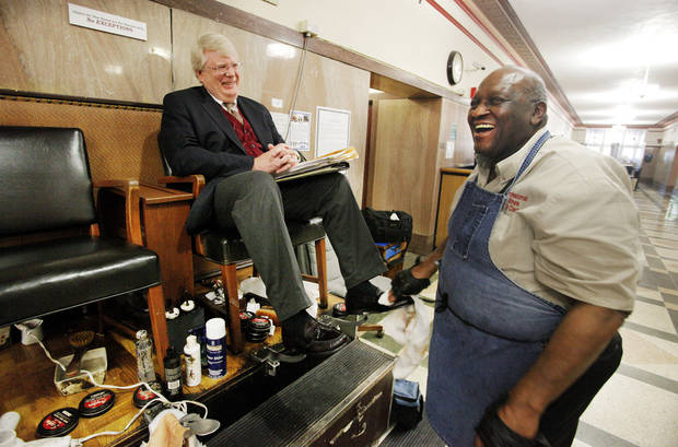 Cleo Fields, right, with Cleo's Professional Shine, laughs while talking with attorney John Foley, of Okla. City, getting his shoes shined at Cleo's shoeshine booth on the ground floor of the Oklahoma County Courthouse in Oklahoma City Friday, March 23, 2012. Photo by Paul B. Southerland, The Oklahoman