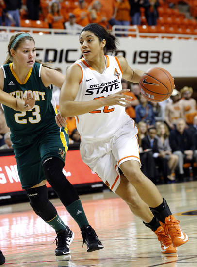 Oklahoma State's Brittney Martin (22) gets by Vermont's Gracia Hutson (23) during the women's college basketball game between Oklahoma State University and Vermont at Gallagher-Iba Arena in Stillwater, Okla., Sunday,Dec. 16, 2012. Photo by Sarah Phipps, The Oklahoman