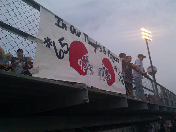 A sign in memory of Cory Casinger and Gordon Parsons hangs on the bleachers at the Stiger-Eufaula game on Friday, Sept. 28. PHOTO BY RYAN ABER, THE OKLAHOMAN