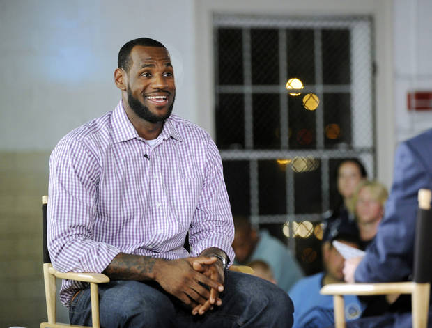 NBA basketball free agent LeBron James waits to make his announcement that he is leaving the Cleveland Cavaliers for the Miami Heat, at the Boys & Girls Club of Greenwich on Thursday, July 8, 2010, in Greenwich, Conn. (AP Photo/Greenwich Time, Bob Luckey) ** MANDATORY CREDIT ** ORG XMIT: NCTGRM201